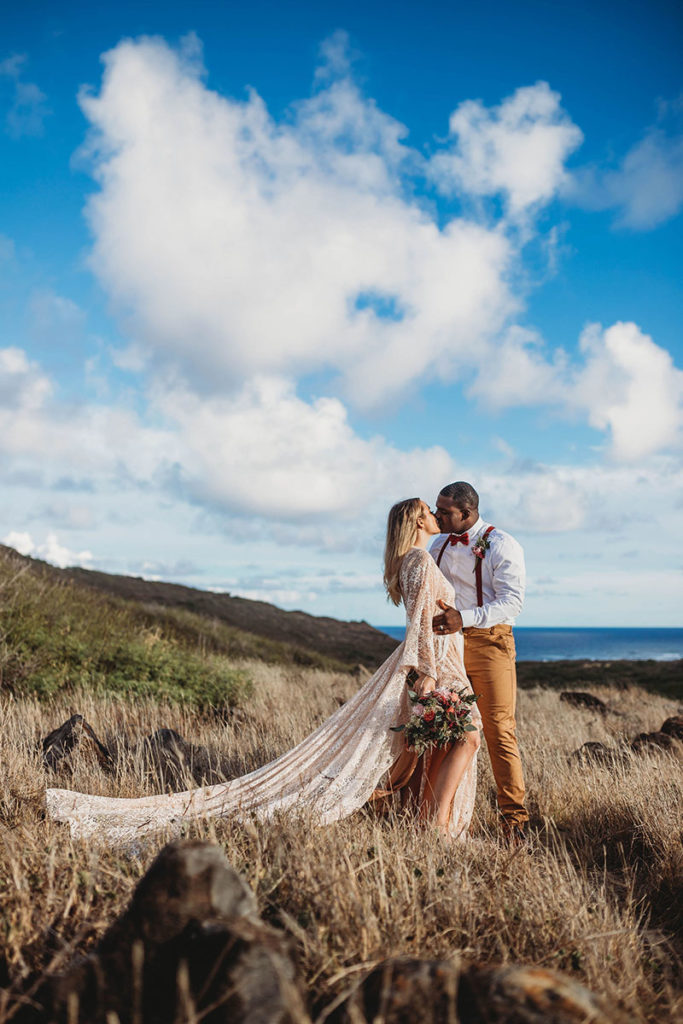 Denver Wedding Photographer, couple kissing on a hillside