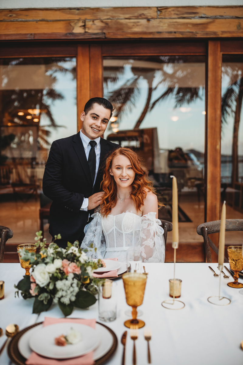 Denver Wedding Photographer, bride and groom sitting at decorated table